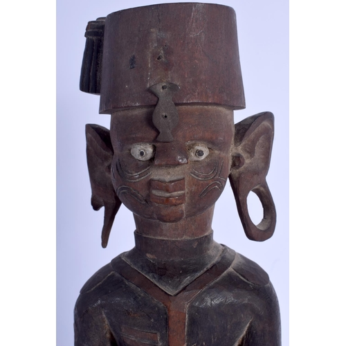 633 - AN EARLY 20TH CENTURY AFRICAN COLONIAL CARVED WOOD TRIBAL FIGURE. 35 cm high....