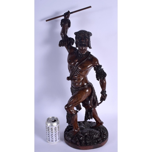 634 - A LARGE EARLY 20TH CENTURY CONTINENTAL CARVED FIGURE OF A TRIBAL WARRIOR. 56 cm high....