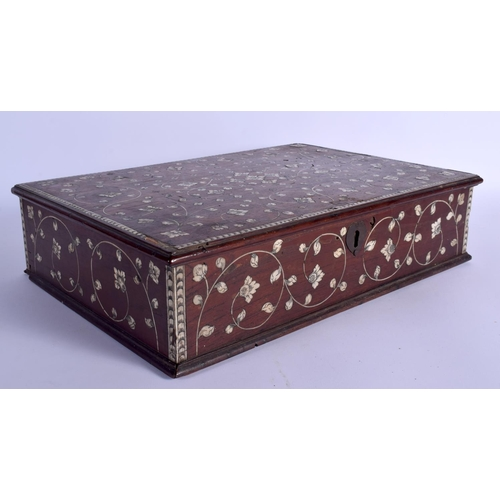 636 - A LARGE 19TH CENTURY ANGLO INDIAN IVORY INLAID HARDWOOD BOX decorated with scrolling foliage and vin...