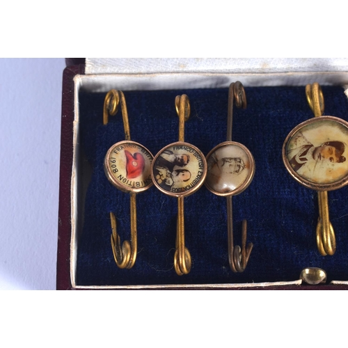 772 - SIX CASED ANTIQUE ENAMELLED PIN BADGES including the Franco British Exhibition 1908. (6)...