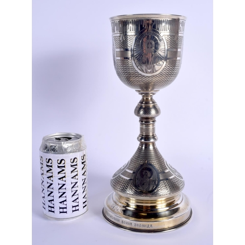 778 - A RARE LARGE 19TH CENTURY RUSSIAN SILVER CHALICE engraved with portraits of saints. 560 grams. 28 cm...