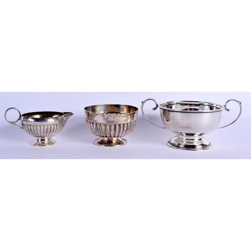 799 - THREE ITEMS OF ENGLISH SILVER including a Victorian cream jug. 282 grams. (3)...