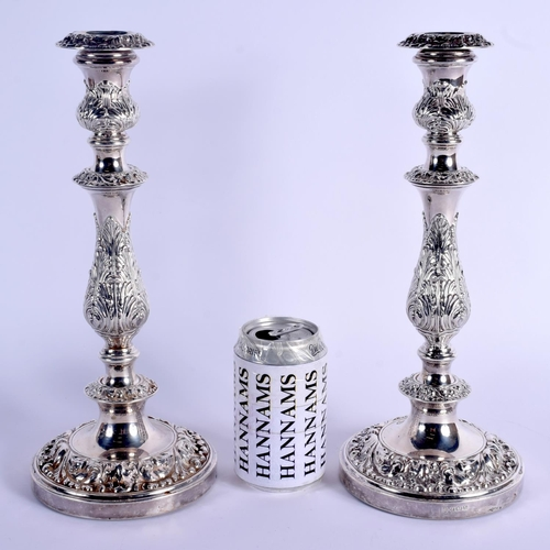 786 - A LARGE PAIR OF ENGLISH SILVER CANDLESTICKS. Birmingham 1948. 2312 grams weighted. 32.5 cm high....
