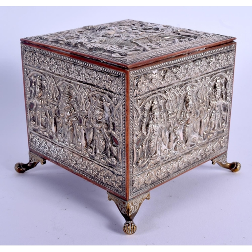 795 - A 19TH CENTURY INDIAN SILVER OVERLAID CASKET decorated with Buddhistic figures. 12 cm x 9 cm....