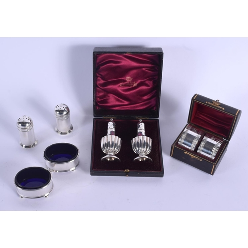 806 - A CASED PAIR OF SILVER CONDIMENTS Birmingham 1876 & a pair of Napkin rings Sheffield 1897 & a plated...