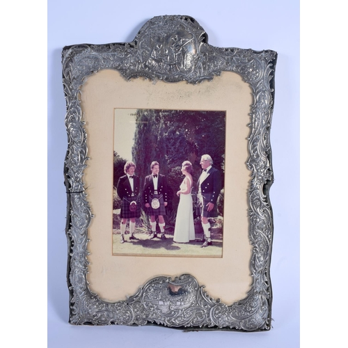 807 - A LARGE VICTORIAN SILVER FRAME decorated with figures within landscapes. Birmingham 1899. 1220 grams...