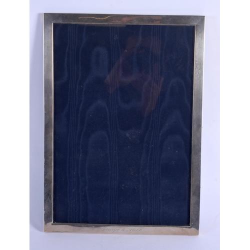 808 - AN ANTIQUE SILVER FRAME. 40 cm x 29 cm....