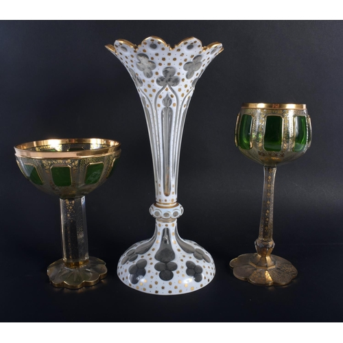 13 - A LARGE ANTIQUE BOHEMIAN WHITE ENAMELLED GLASS VASE together with two green & gilt glasses. Largest ...