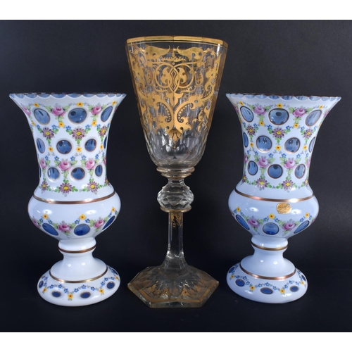 16 - A LARGE ANTIQUE GILT OVERLAID GLASS VASE together with a pair of bohemian white enamel overlaid vase...