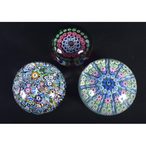 21 - THREE VINTAGE EUROPEAN GLASS PAPERWEIGHTS. Largest 6.75 cm diameter. (3)
