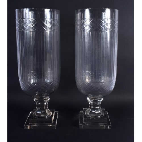 28 - A LARGE PAIR OF CUT GLASS STORM CELERY VASES. 40 cm high.