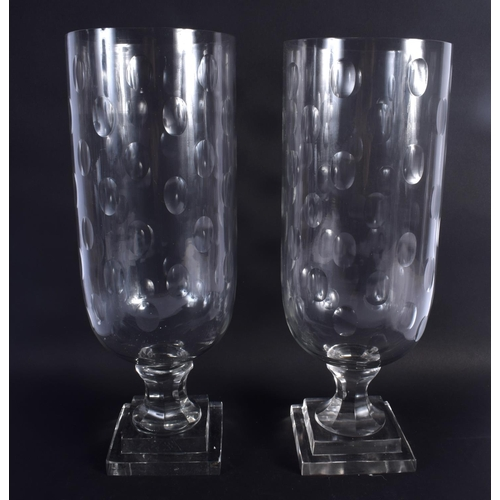 29 - A LARGE PAIR OF CUT GLASS STORM CELERY VASES. 40 cm high.