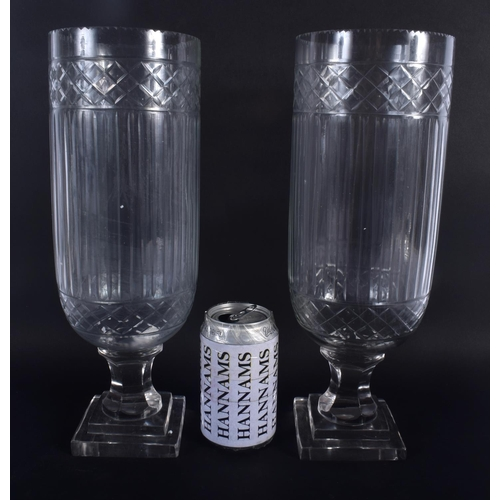 30 - A LARGE PAIR OF CUT GLASS STORM CELERY VASES. 34 cm high.