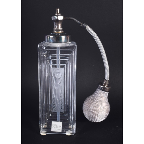 41 - A BOXED LALIQUE GLASS SCENT BOTTLE decorated with a nude female. Bottle 19 cm high.