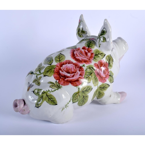 52 - A LARGE VINTAGE SCOTTISH WEYMSS STYLE PIG painted with floral sprays. 36 cm x 25 cm.