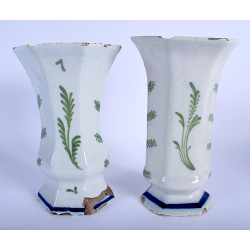 54 - A PAIR OF 19TH CENTURY DUTCH DELFT FAIENCE TIN GLAZED VASES painted with landscapes. 22 cm x 12 cm.