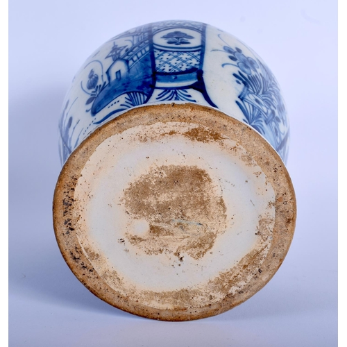 55 - AN 18TH CENTURY DUTCH DELFT BLUE AND WHITE BALUSTER VASE painted with floral sprays. 23 cm x 12 cm.