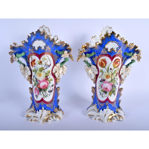 63 - A LARGE PAIR OF 19TH CENTURY FRENCH PARIS PORCELAIN VASES painted with floral sprays. 31 cm x 16 cm.