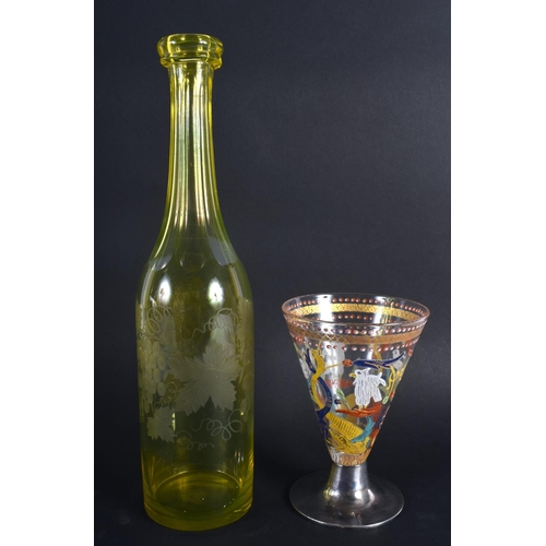 8 - A VINTAGE YELLOW GLASS ENGRAVED DECANTER together with an early silver mounted European glass goblet...