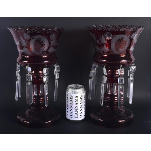 9 - A LARGE PAIR OF VINTAGE RUBY GLASS TABLE LUSTRES decorated with landscapes. 30 cm x 18 cm.