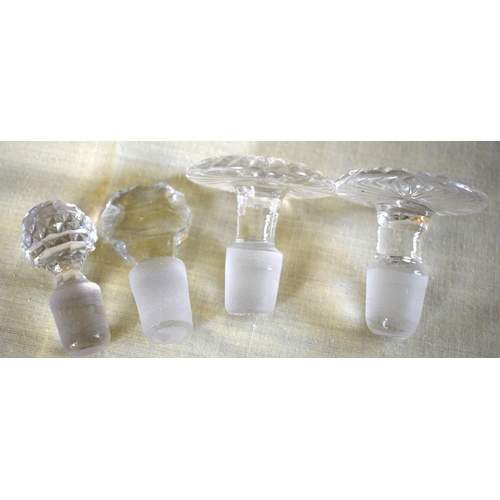 11 - A PAIR OF ANTIQUE CUT GLASS DECANTERS AND STOPPERS together with two other decanters. Largest 23 cm ...