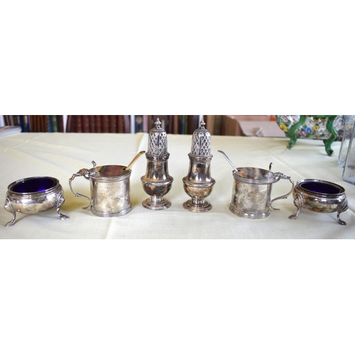 17 - TWO ENGLISH SILVER CRUET SETS comprising of mustard, pepper and salts, some with sapphire blue glass...