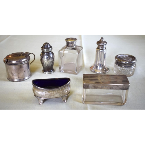 18 - AN ART DECO SILVER DRESSING TABLE SET together with two silver frames, silver topped bottles & jars ...