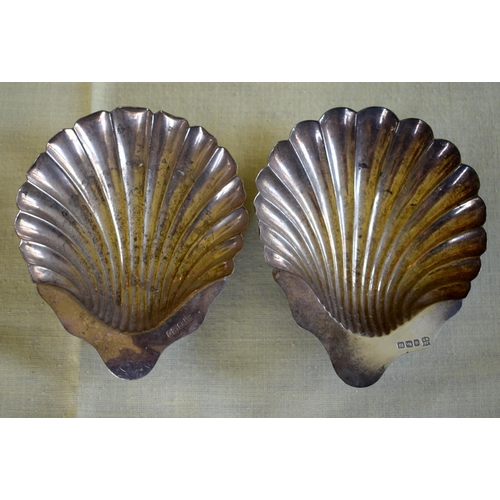 19 - A PAIR OF SILVER SHELL FORM BUTTER DISHES of naturalistic inspiration. Sheffield 1929. 124 grams. 11...