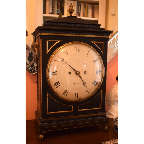 2 - A GEORGE III EBONISED MAHOGANY BRACKET CLOCK by Molyneux of London, lion mask head handles and circu...