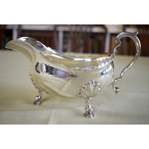 21 - A GEORGE III STYLE SILVER SAUCE BOAT Retailed by Tessiers of London. London 1963. 355 grams. 22 cm x...