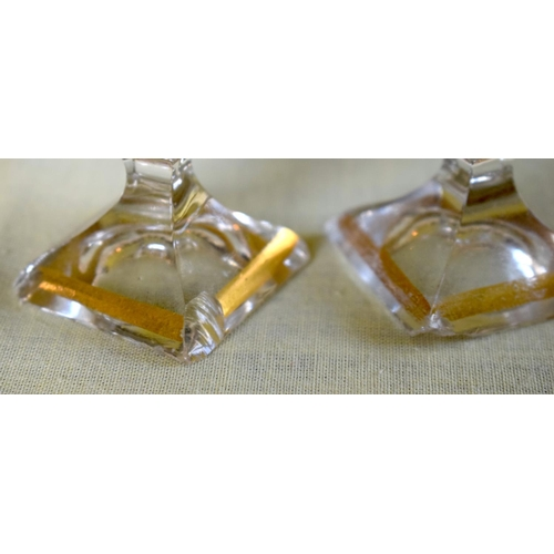 24 - A SET OF FOUR 19TH CENTURY BOHEMIAN CLEAR AND GILDED LIQUOR DECANTERS AND STOPPERS together with mat...