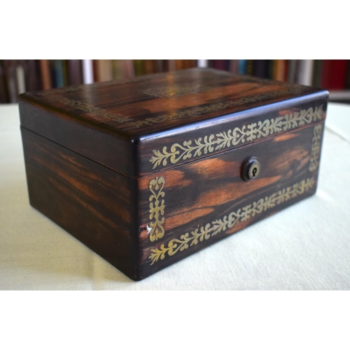 31 - AN EARLY VICTORIAN COROMANDEL BRASS INLAID BOX AND COVER decorated with floral type motifs. 21 cm x ...