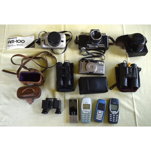 34 - A COLLECTION OF VINTAGE 35MM CAMERAS together with four vintage Nokia phones, binoculars etc. (qty)