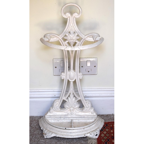 38 - AN ARTS AND CRAFTS CAST IRON UMBRELLA STAND in the manner of Dresser. 66 cm x 27 cm.