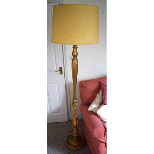 47 - A REGENCY STYLE GILT PAINTED STANDARD LAMP with acanthus mounts. Gilt 147 cm high.