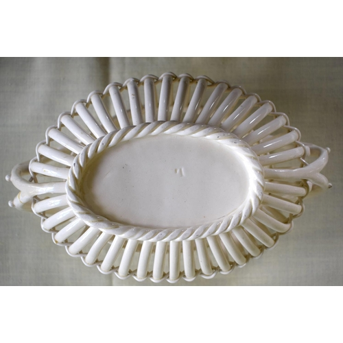 5 - AN ANTIQUE CONTINENTAL CREAMWARE STYLE CHINA BASKET modelled in the style of Leeds. 22 cm x 10 cm.