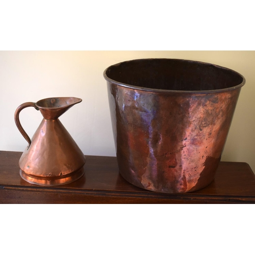 56 - A VINTAGE COPPER WASTE PAPER BASKET, along with a small copper jug. Largest 30 cm x 27 cm. (2)