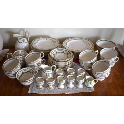 57 - A THOMAS GOODE & CO PORCELAIN TEASET decorated with swags and  vines. (qty)