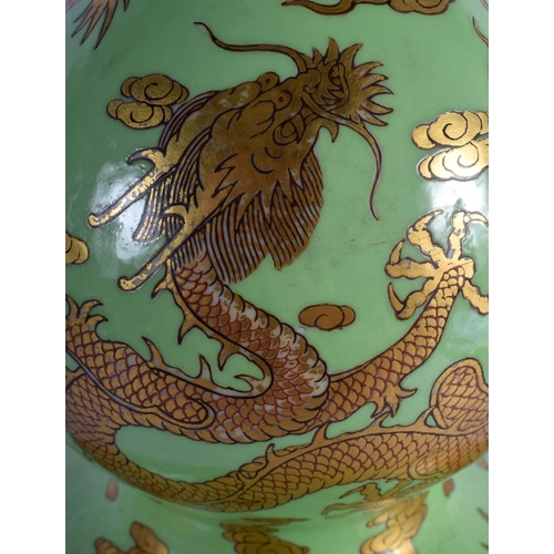 59 - A VERY RARE CHINESE DOUBLE GOURD DRAGON VASE with golden cloud and dragion design on green ground.  ...
