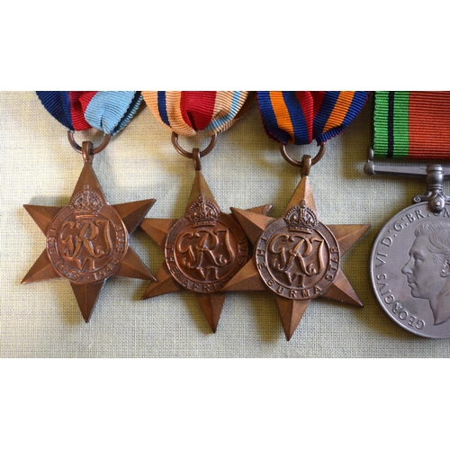 8 - TWO WWII MEDAL GROUPS including territorial, with original ribbons. (10)