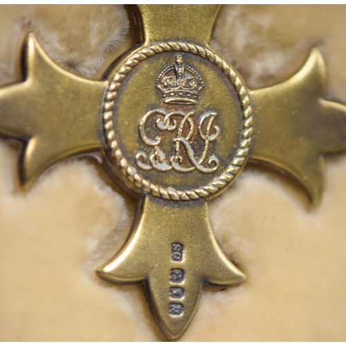 9 - A GEORGE V SILVER GILT CASED OBE MEDAL in original fitted case. Medal 6.5 cm  x 4.5 cm.