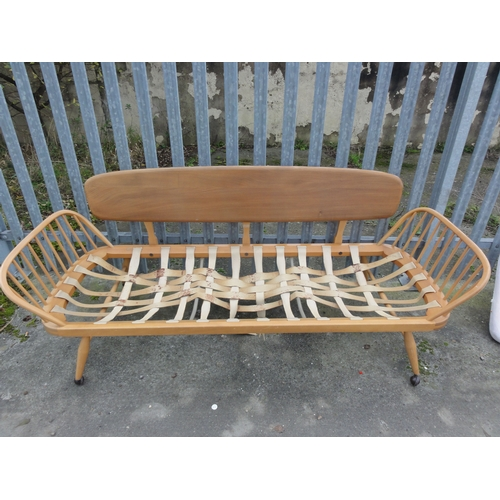 568 - Retro Ercol style beech 7ft day bed, together with contemporary covers (no fillings), strapping requ...