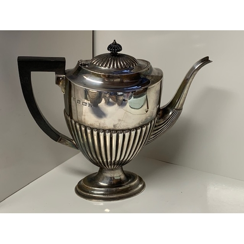 146 - An Elizabeth II 4-piece silver tea and coffee service, each piece oval and with part fluted lower bo...