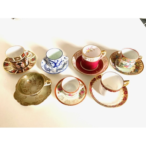 16 - 7 decorative coffee cups and saucers including 2 Royal Crown Derby