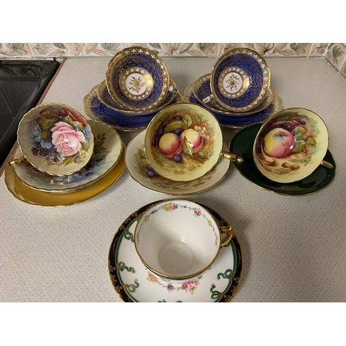 48 - Aynsley trio, 2 Aynsley cups & saucer, 2 decorative blue and gilt trios and Royal Crown Derby cup & ...