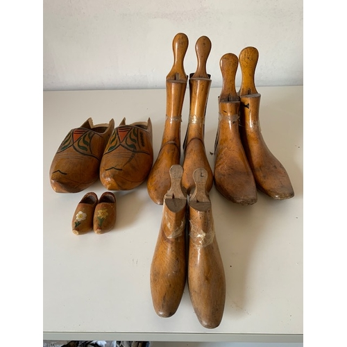 462 - 3 Pairs Victorian wooden cobblers moulds and 2 pairs painted wooden clogs