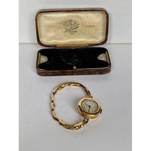 190 - 18ct gold ladies wrist watch with stylic gold spring strap stamped 18ct, watch and strap 24.8gms