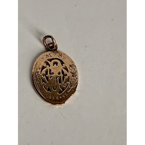 169A - Small 2cms yellow metal pendant 'Quietness, Confidence, Strength' 1896-97, 1.95gms