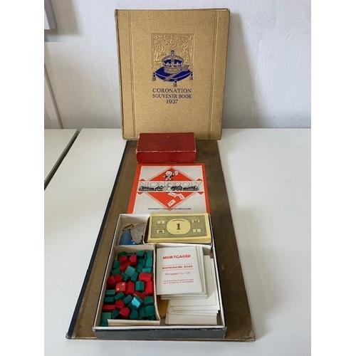 240 - 1937 Coronation Souvenir Book, old Monopoly set and Golden Gram Promises game