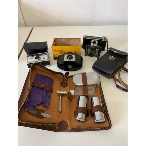 228 - 3 cameras including Kodak Brownie 127 and gents cased grooming set